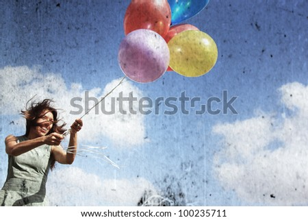 Young woman with colorful balloons. Photo in old image style. - stock photo