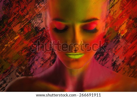 Young woman with colorful makeup on a colored background - stock photo