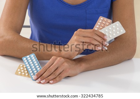 Young woman with Contraceptive Pill - stock photo