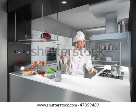 Young woman with cooks uniform and toque in a modern industrial kitchen
