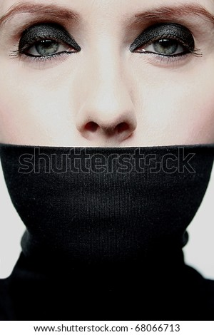 Young woman with covered mouth - stock photo
