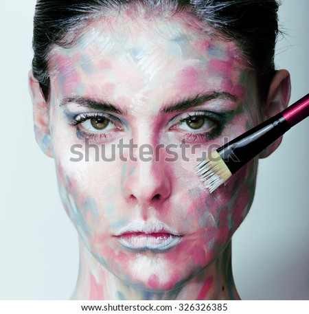 young woman with creative make up like painted oil picture on face closeup - stock photo