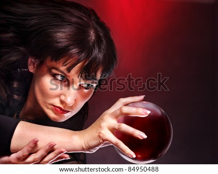 Young woman  with crystal ball. Fortune telling.