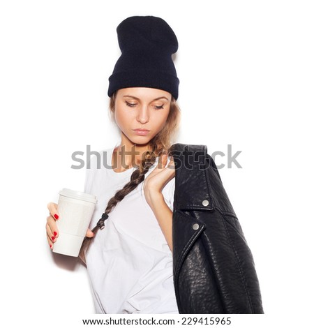 Young woman with cup of coffee. Close-up lifestyle indoor portrait, not isolated - stock photo