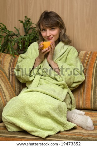 Young woman with cup of hot drink - stock photo