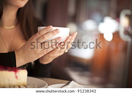 young woman with cup of italian coffee cappuccino in cafe restaurant - stock photo