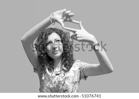 Young woman with curly hair taken photo from her hand. BW photo. - stock photo