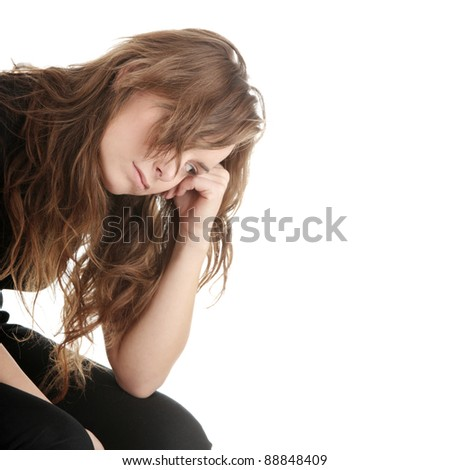 Young woman with depression isolated on white - stock photo