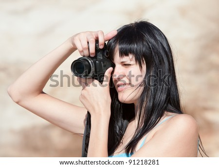 Young woman with digital photocamera - stock photo