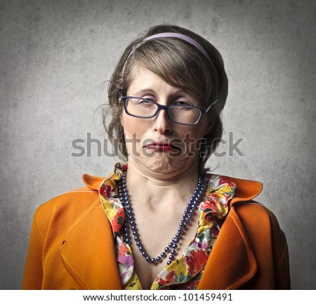 Young woman with disgusted expression
