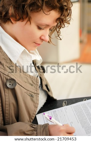 Young woman with documents binder - stock photo