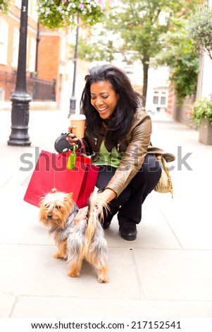 young woman with dog and shopping bags. - stock photo