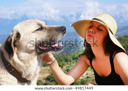 Young woman with dog outdoors. - stock photo