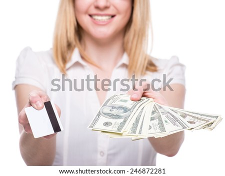Young woman with dollars and card in her hands, isolated on white background.