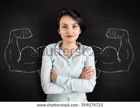 Young woman with drawn powerful arms - stock photo