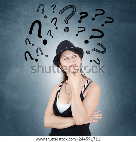 Young woman with drawn question marks above her head - stock photo