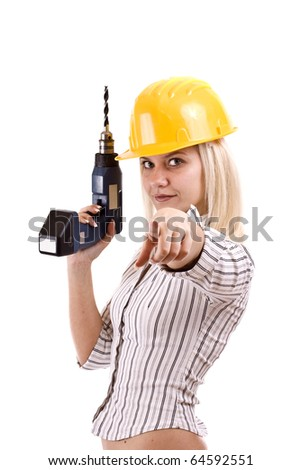 Young woman with drill machine - stock photo
