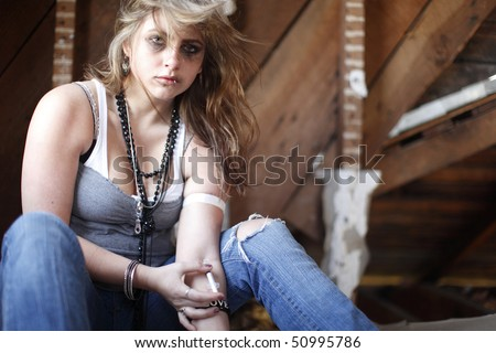Young woman with drug addiction. - stock photo