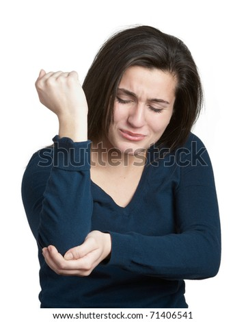 Young woman with elbow pain on white background - stock photo