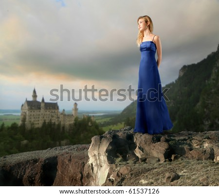 Young woman with elegant dress with castle on the background - stock photo