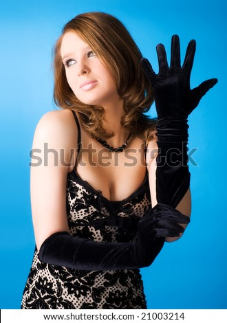 Young woman with elegant gloves. On blue background. - stock photo