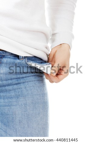 Young woman with empty pockets - stock photo