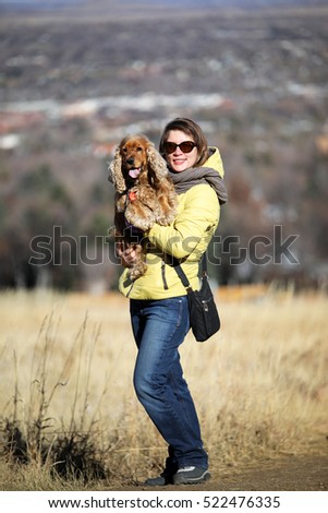 young woman with English cocker spaniel
