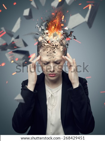 Young woman with exploding brain - stock photo