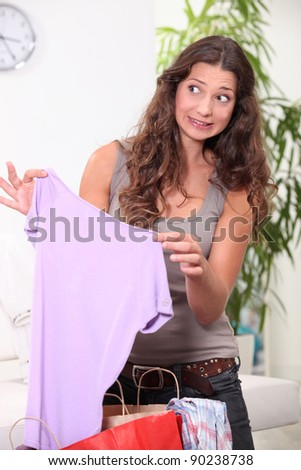 Young woman with expression of fear - stock photo