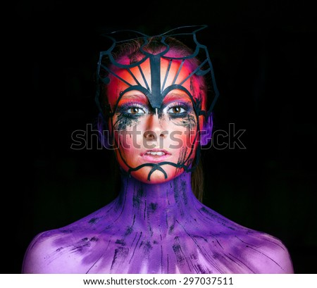 Young woman with fantasy make up - stock photo