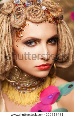 young woman with fashion makeup on brown background
