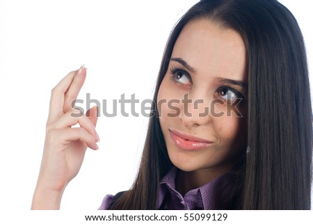 Young woman with fingers crossed on white - stock photo