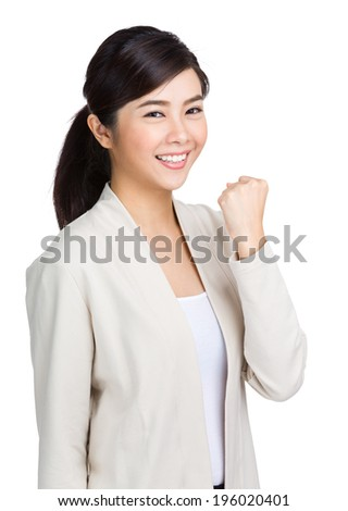 Young woman with fist up - stock photo