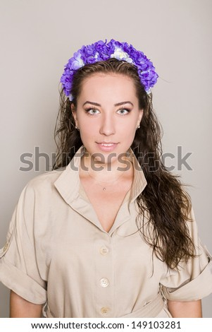 young woman with flower wreath on head - stock photo