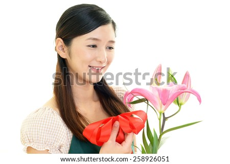 Young woman with flowers. - stock photo