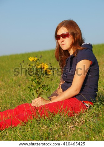 Young woman with flowers - stock photo