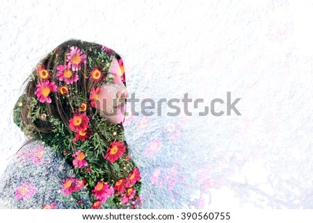 Young woman with flowers. Double exposure made with the camera. - stock photo