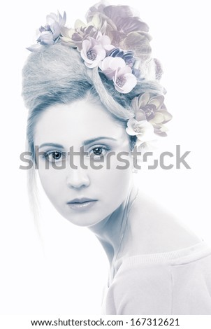 Young woman with flowers in her hair.