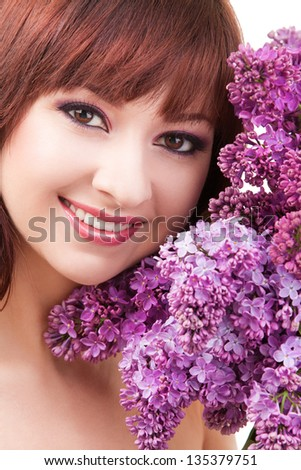 Young woman with flowers on white background