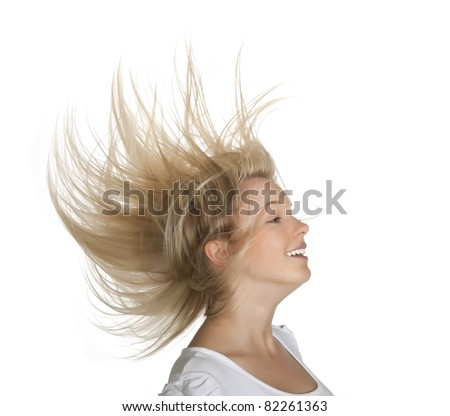 young woman with flying hairs - stock photo