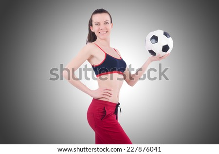 Young woman with football on white - stock photo