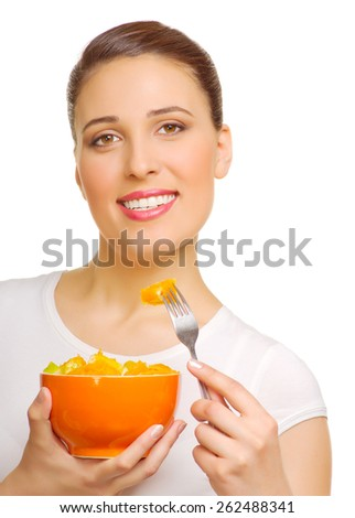 Young woman with fruit salad isolated - stock photo