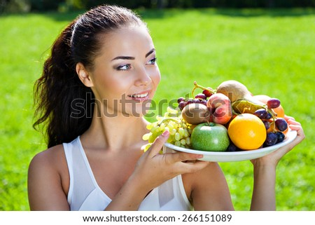 Young woman with fruits, healthy food concept, skin care and beauty, vitamins and minerals