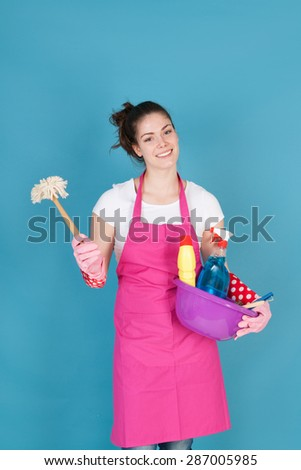 Young woman with full equipment to clean the interior - stock photo