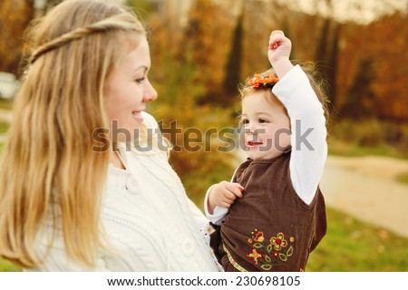 young woman with funny baby daughter - stock photo