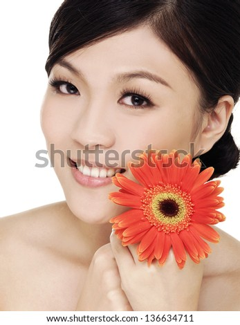 young woman with gerber flower, Beauty treatment concept. - stock photo
