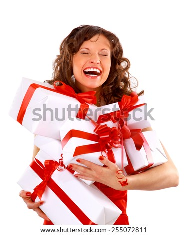 young woman with gifts. Shot in studio.   - stock photo