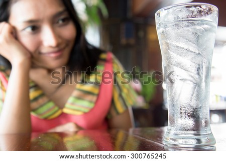 Young Woman with glass of fresh Water - stock photo
