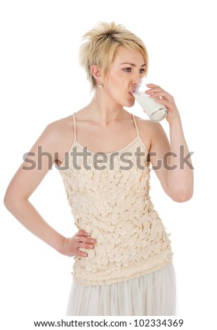 young woman with glass of milk. isolated on white background - stock photo