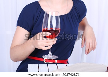 Young woman with glass of red wine  - stock photo